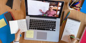 remote tutoring with a tutor on screen and working at desk